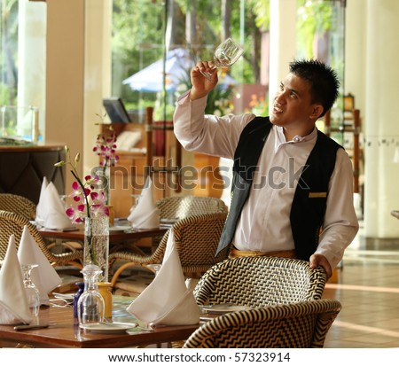 waiter at restaurant - stock photo