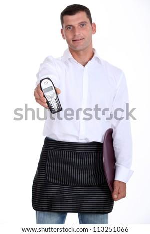 waiter bringing a phone - stock photo