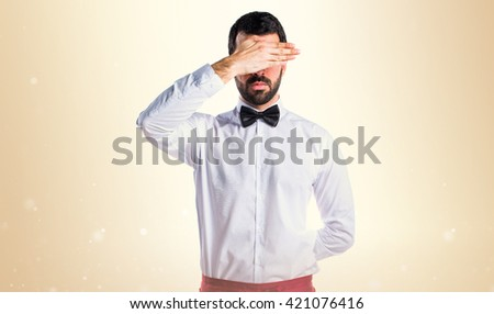 Waiter covering his eyes