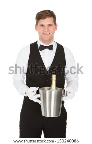 Waiter Holding A Wine Cooler With A Bottle Of Champagne