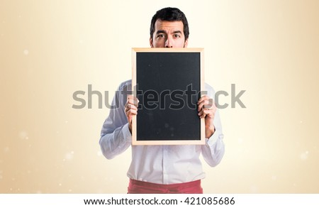 Waiter holding an empty placard