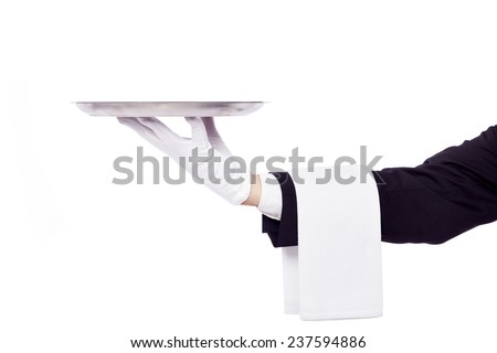 Waiter holding an empty silver tray over white background - stock photo