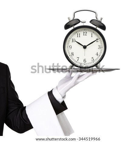Waiter holding silver tray with an old clock isolated on white background