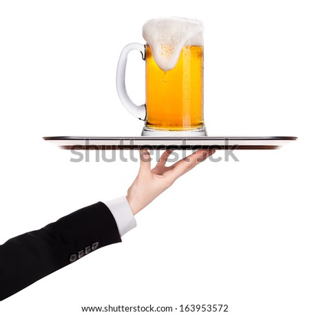 waiter holding  silver tray with beer isolated on a white background - stock photo