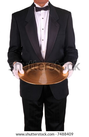 Waiter in Tuxedo with Gold Serving Tray isolated over white. Man is unrecognizable. - stock photo