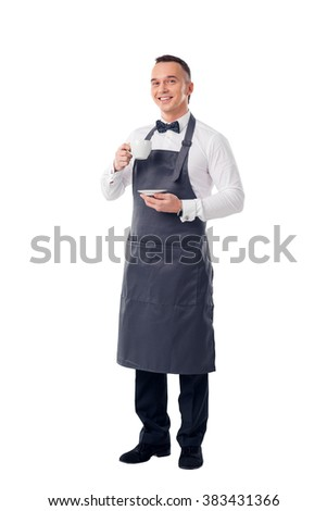 Waiter man serving coffee wearing apron - stock photo