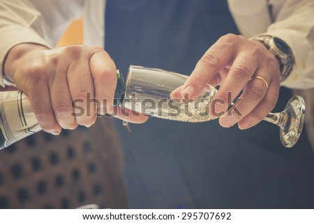 Waiter pouring wine, photo with effect vintage - stock photo