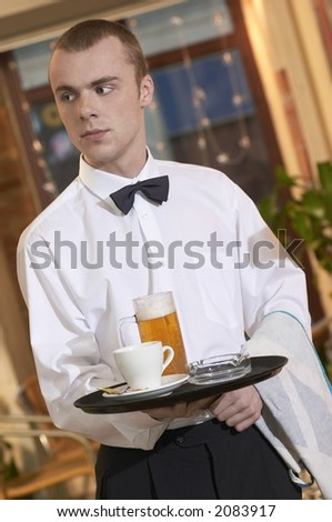 waiter serving beer and coffe in coffe bar
