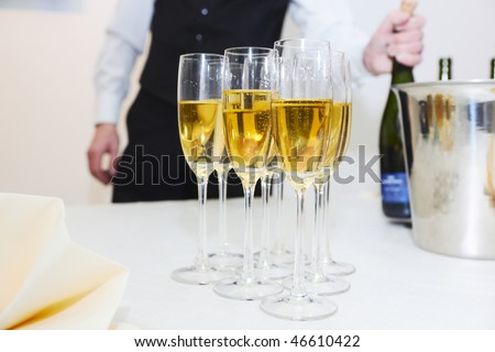 Waiter serving champagne, shallow focus depth - stock photo
