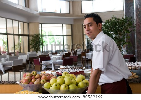 Waiter serving fresh fruits at restaurant. - stock photo