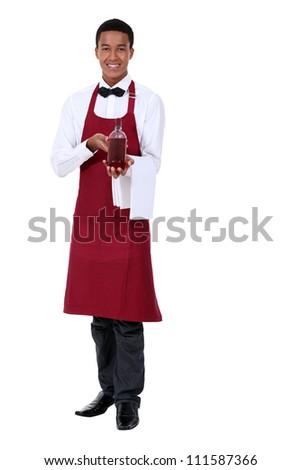 Waiter showing bottle - stock photo