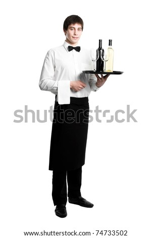 Waiter sommelier with bottle of red white wine and stemware glass on tray - stock photo