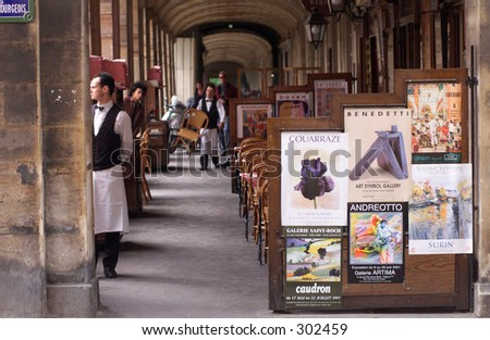 Waiter standing at a restaurant in Paris, France, - stock photo