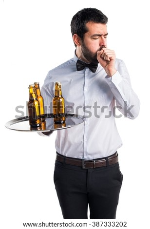 Waiter with beer bottles on the tray coughing a lot
