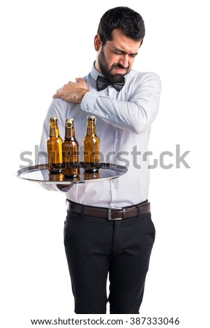 Waiter with beer bottles on the tray with shoulder pain