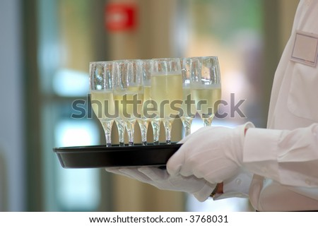waiter with dish of vine glasses