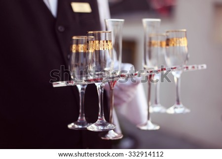 Waiter with glasses of champagne - stock photo