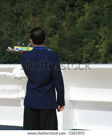 Waiter with Tray on Cruise Ship