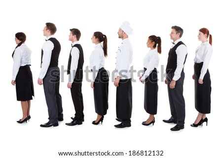 Waiters and waitresses standing in queue. Isolated on white - stock photo