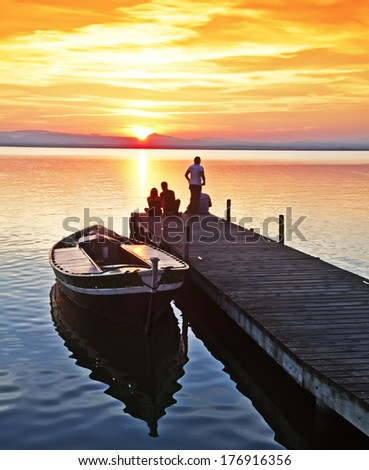 waiting for dawn to go fishing - stock photo