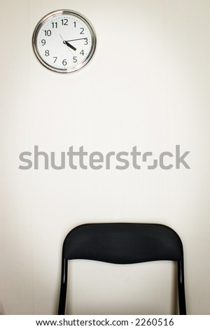 waiting room chair and wall - stock photo