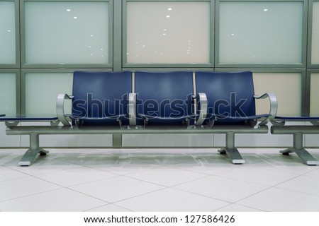 Waiting room, chairs against a glass wall - stock photo