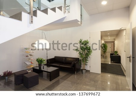 Waiting room or reception in office interior - stock photo