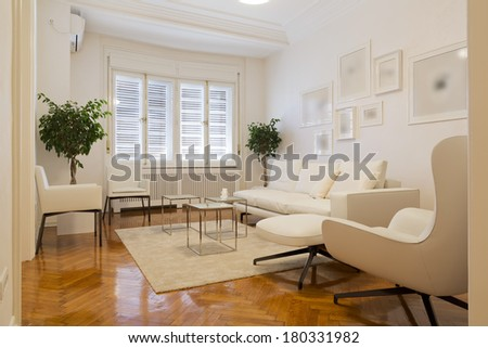 Waiting room with white furniture - stock photo