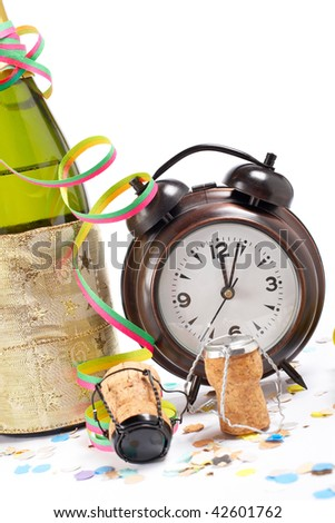 Waiting the New Year with champagne bottle and clock. Shallow depth of field. Shallow depth of field