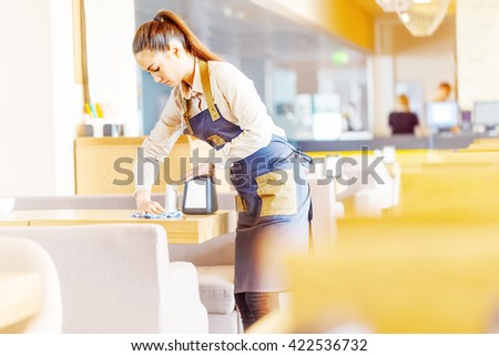 Waitress cleaning table - stock photo