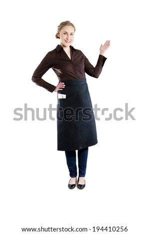 Waitress pointing. Woman in apron smiling happy isolated on white background.  - stock photo