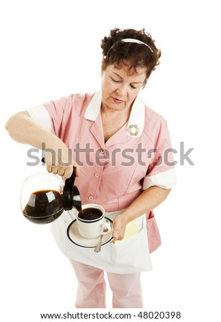 Waitress pours a cup of coffee.  Isolated on white.