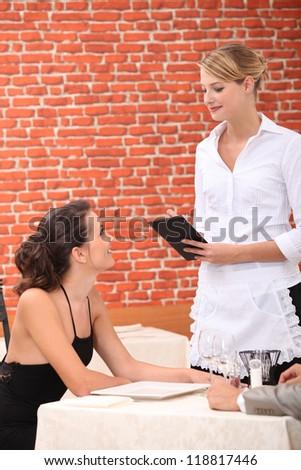 Waitress serving customer - stock photo