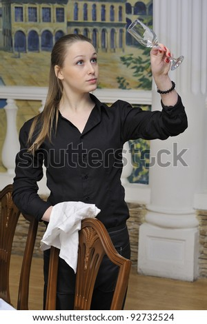 waitress wiped the glasses in restaurant - stock photo