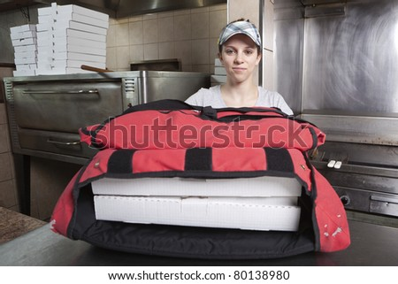 Waitress with take out pizza in a thermal bag - stock photo