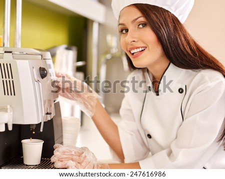 Waitresses with coffee machine at cafeteria. Woman pours coffee - stock photo