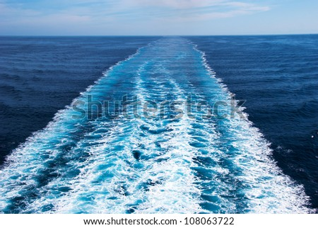 Wake in the ocean made by cruise ship - stock photo