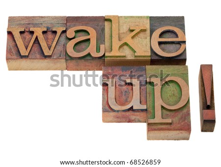wake up - exclamation phrase in vintage wooden letterpress printing blocks, stained by color inks, isolated on white - stock photo