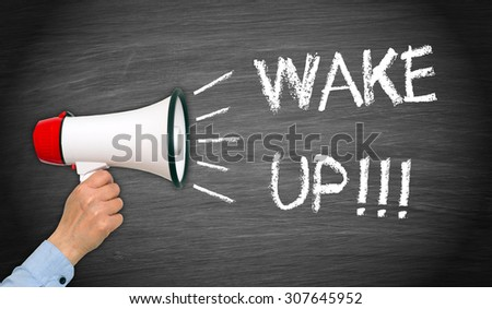 Wake up ! - female hand with megaphone and text - stock photo