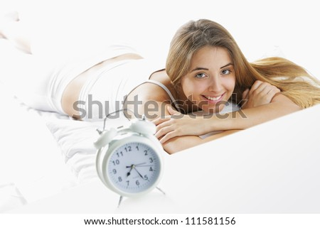 Wake up. Young woman on bed at morning - stock photo