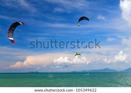 Wakeboarders jumping from water in open sea. Koh Samui, Thailand - stock photo