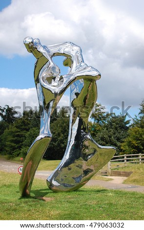 WAKEFIELD, UK - AUGUST 6, 2016. A polished stainless steel sculpture by Swiss artist Not Vital, at Yorkshire Sculpture Park, Wakefield, UK.