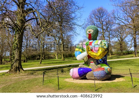 WAKEFIELD, YORKSHIRE, UK - APRIL 19TH 2016:  Buddha Sculpture by Niki de Saint  Phalle exhibited at the Yorkshire Sculpture Park. - stock photo