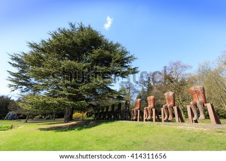WAKEFIELD, YORKSHIRE, UK - APRIL 19, 2016: The great Polish artist Magdalena Abakanowicz returns to YSP with the UK premiere of her monumental sculpture, Ten Seated Figures. - stock photo
