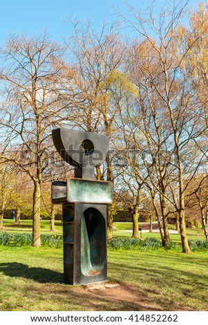WAKEFIELD, YORKSHIRE, UK - APRIL 19, 2016: The Ultimate Form is part of 9 individual bronze sculptures, one of Barbara Hepworths final works The Family of Man, completed in 1970 exhibited in YSP. - stock photo