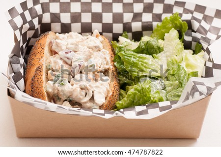 Waldorf Styled Chicken Salad Sandwich With Grapes And Walnuts And Caesar Salad