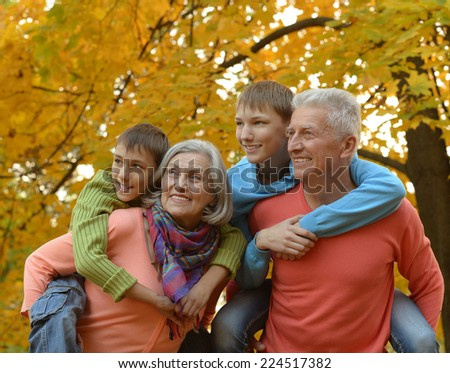 walk a large family in the woods - stock photo
