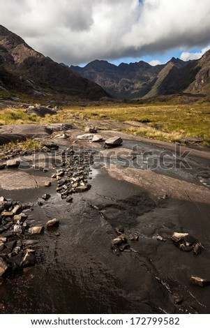 Walk along the foot of the Black Cuilin, Isle of Skye, Scotland - stock photo