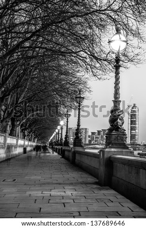 Walk along the Thames in London - stock photo