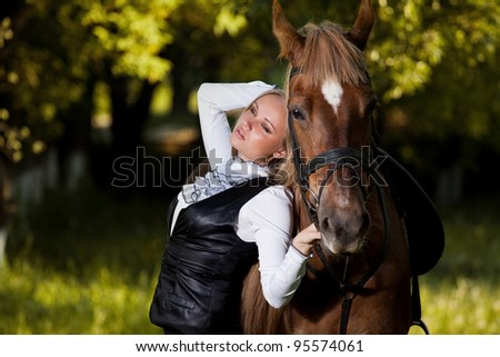 Walk of beautiful young girl with a horse